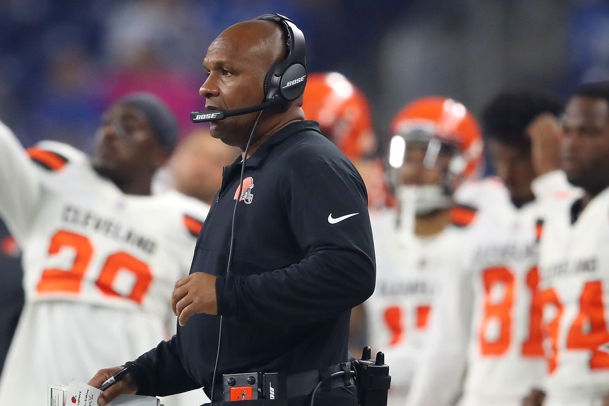 Hue Jackson looks on at a game wearing his headset