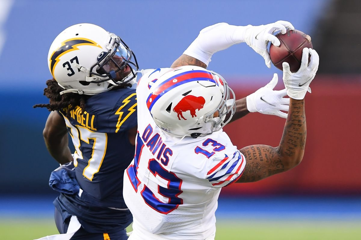 Buffalo Bills wide receiver Gabriel Davis (13) catches a pass as Los Angeles Chargers cornerback Tevaughn Campbell (37) defends during the fourth quarter at Bills Stadium.