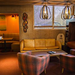 Whereas the upstairs at BeetleCat is yacht themed, downstairs has a markedly surfer den feel. The lounge area downstairs.