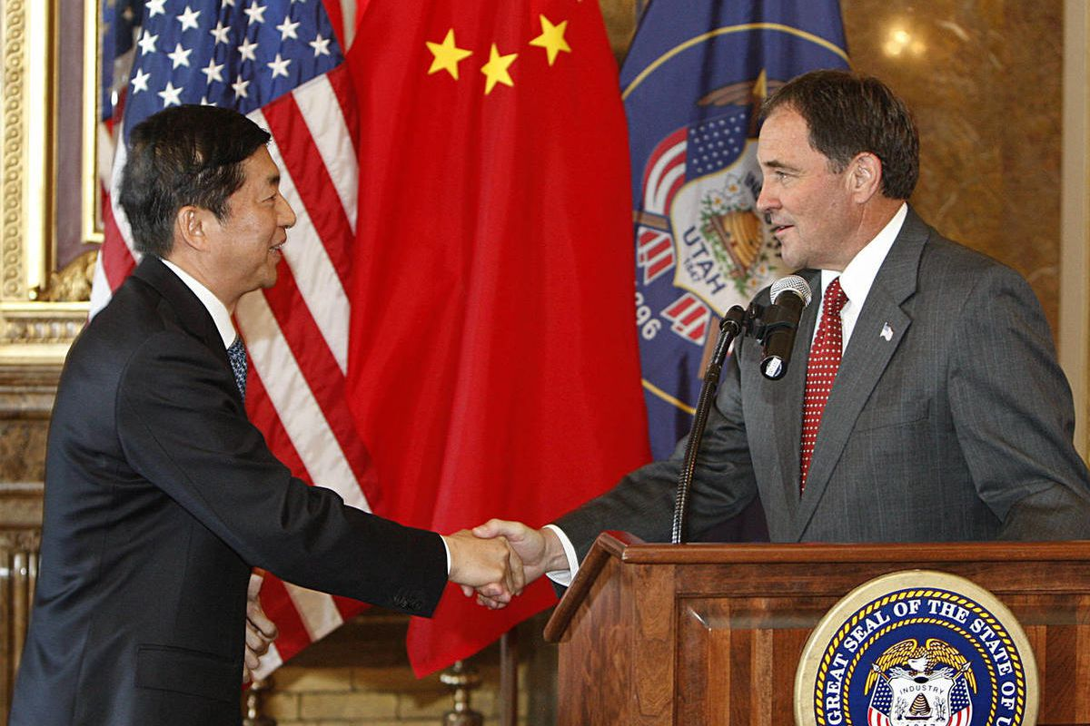 China's Qinghai Governor Luo Huining, left, and Utah Governor Gary Herbert meet before signing the Memorandum of Understanding (MOU) signing ceremony in the Gold Room at the Utah State Capitol Wednesday, July 13, 2011, in Salt Lake City, Utah.