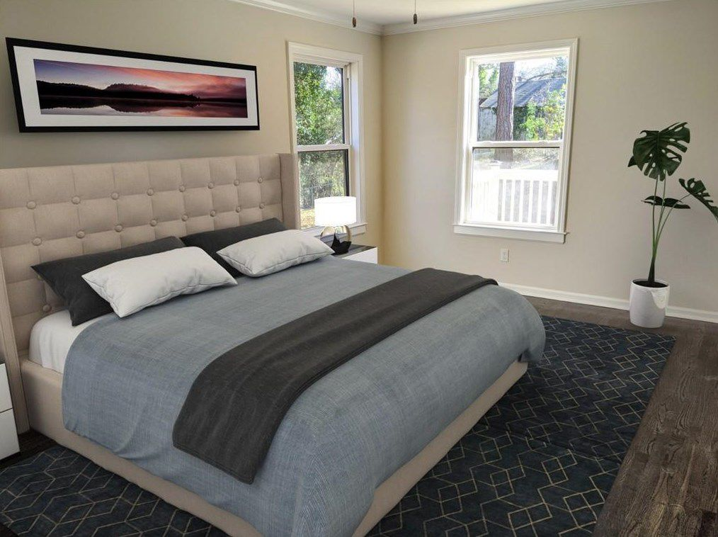 A master bedroom with digital furnishings including a plant and gray bed.