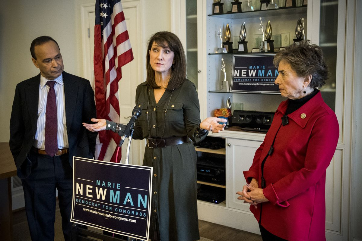 Marie Newman (center) candidate for Congress in IL-03, speaks during event to receive the endorsement of Reps. Jan Schakowsky, (D-IL), (right) and Rep. Luis Gutierrez, (D-IL) on January 17, 2018.