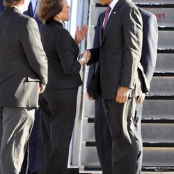 President Barack Obama, right, is greeted by Gov. Susana Martinez, center, and Roswell Mayor Del Jurney, left, during his arrival at Roswell International Air Center airport, March, 21, 2012, in Roswell, N.M.