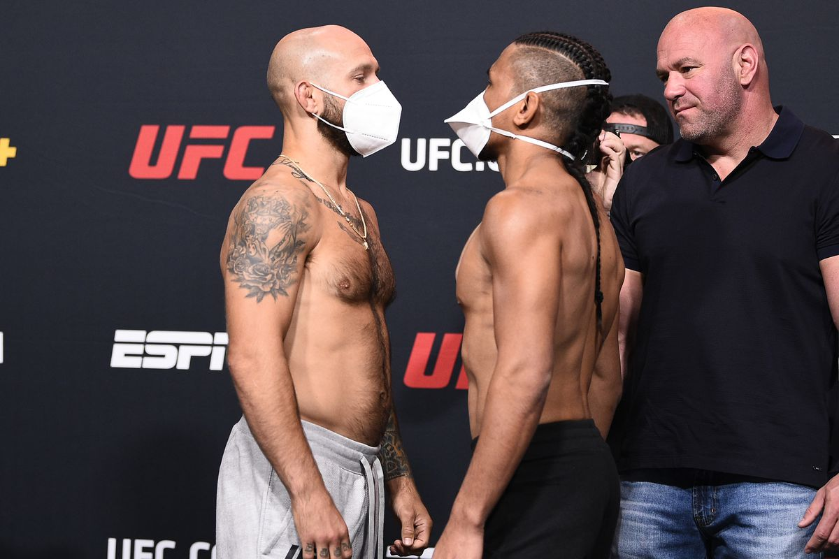 Opponents Brian Kelleher and Kevin Natividad face off during the UFC Fight Night weigh-in at UFC APEX on September 04, 2020 in Las Vegas, Nevada.