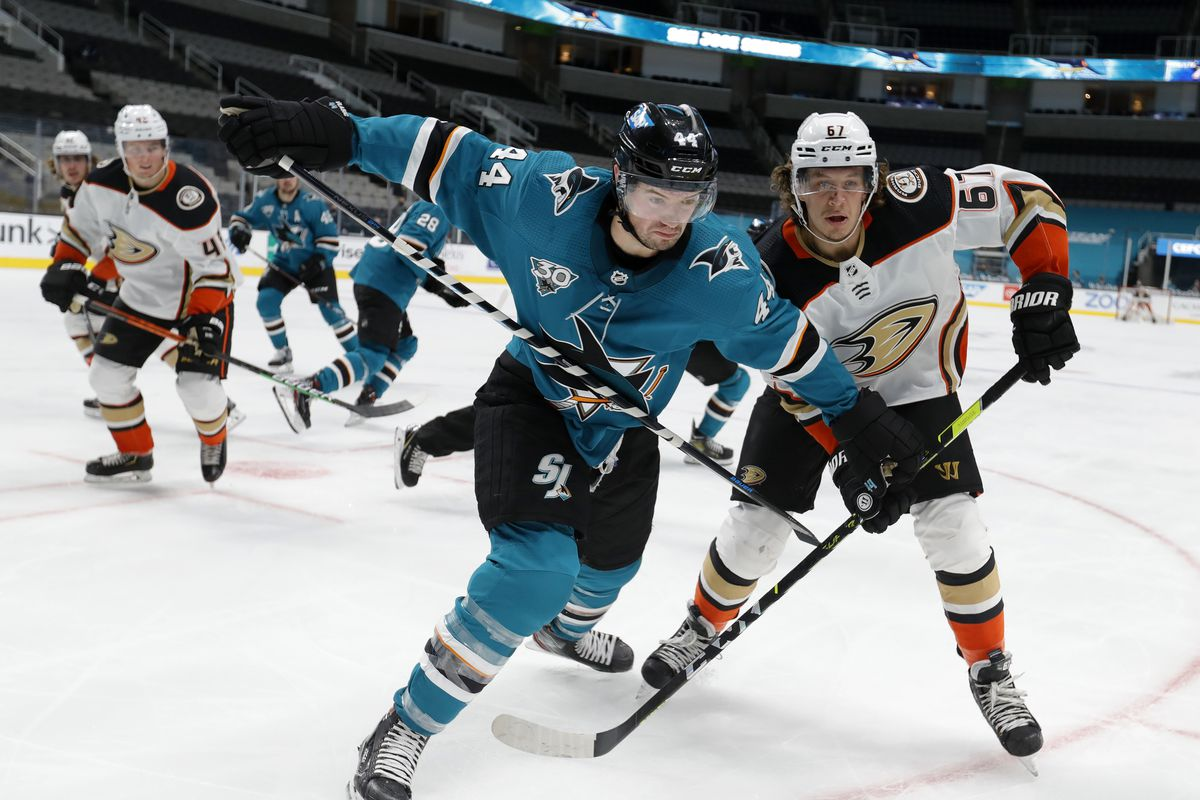 San Jose Sharks' Marc-Edouard Vlasic #44 and Anaheim Ducks' Rickard Rakell #67 chase a puck up against the boards during the second period of their NHL game at the Sap Center in San Jose, Calif., on Monday, Feb. 15, 2021.