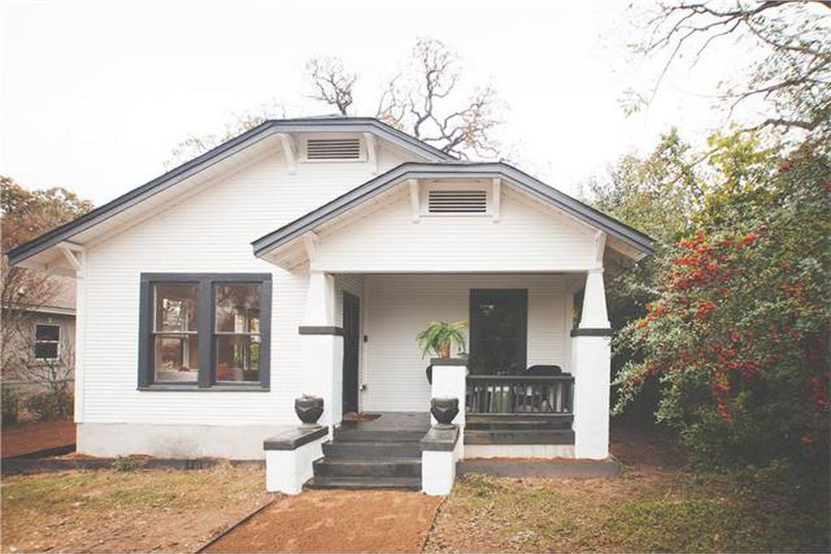 Small white craftsman house with blue trim