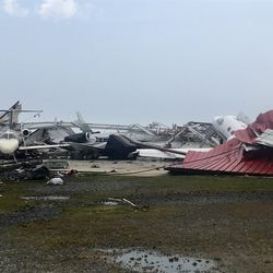A destroyed hangar and damaged planes are seen at Monroe Regional Airport in Monroe, La., Sunday, April 12, 2020.