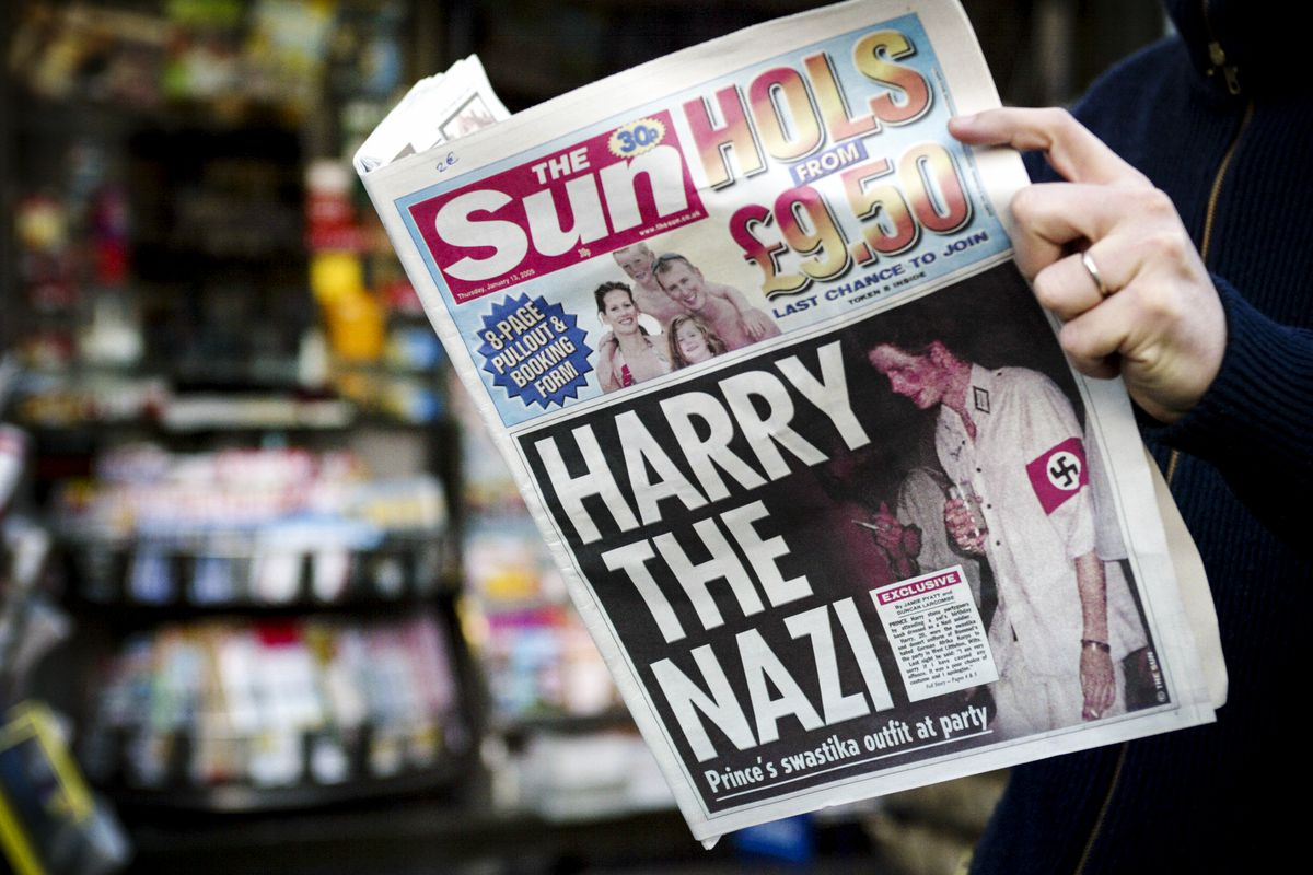 The British tabloid, The Sun, featured Prince Harry, 20, on its cover wearing a swastika armband, on January 13, 2005.