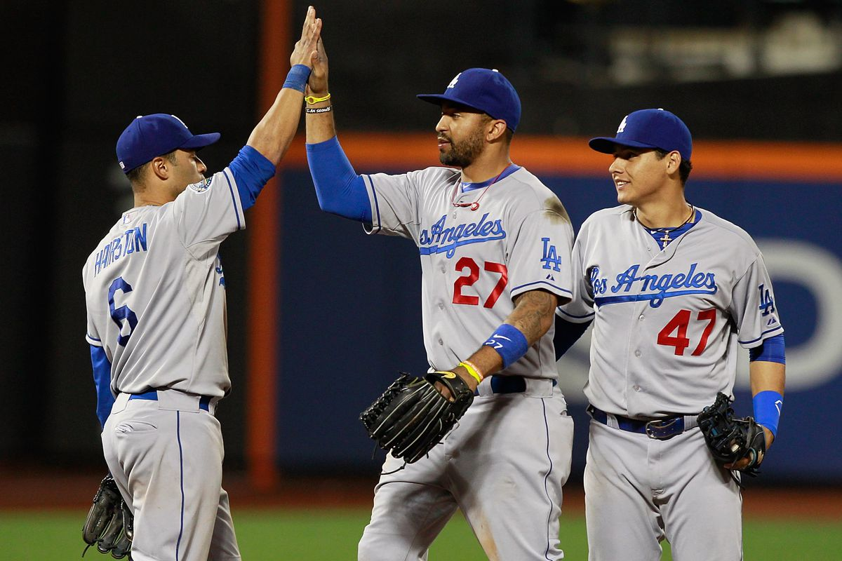 Jerry Hairston congratulates the top two Dodgers in hits and RBI in July.