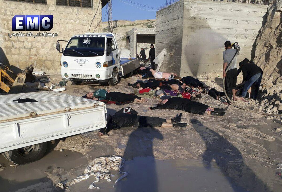 This photo provided by the Syrian anti-government activist group Edlib Media Center, which has been authenticated based on its contents and other Associated Press reporting, shows victims of a suspected chemical attack in the town of Khan Sheikhoun. The s
