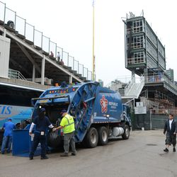 2:54 p.m. Trash being brought out of the ballpark, on Sheffield -