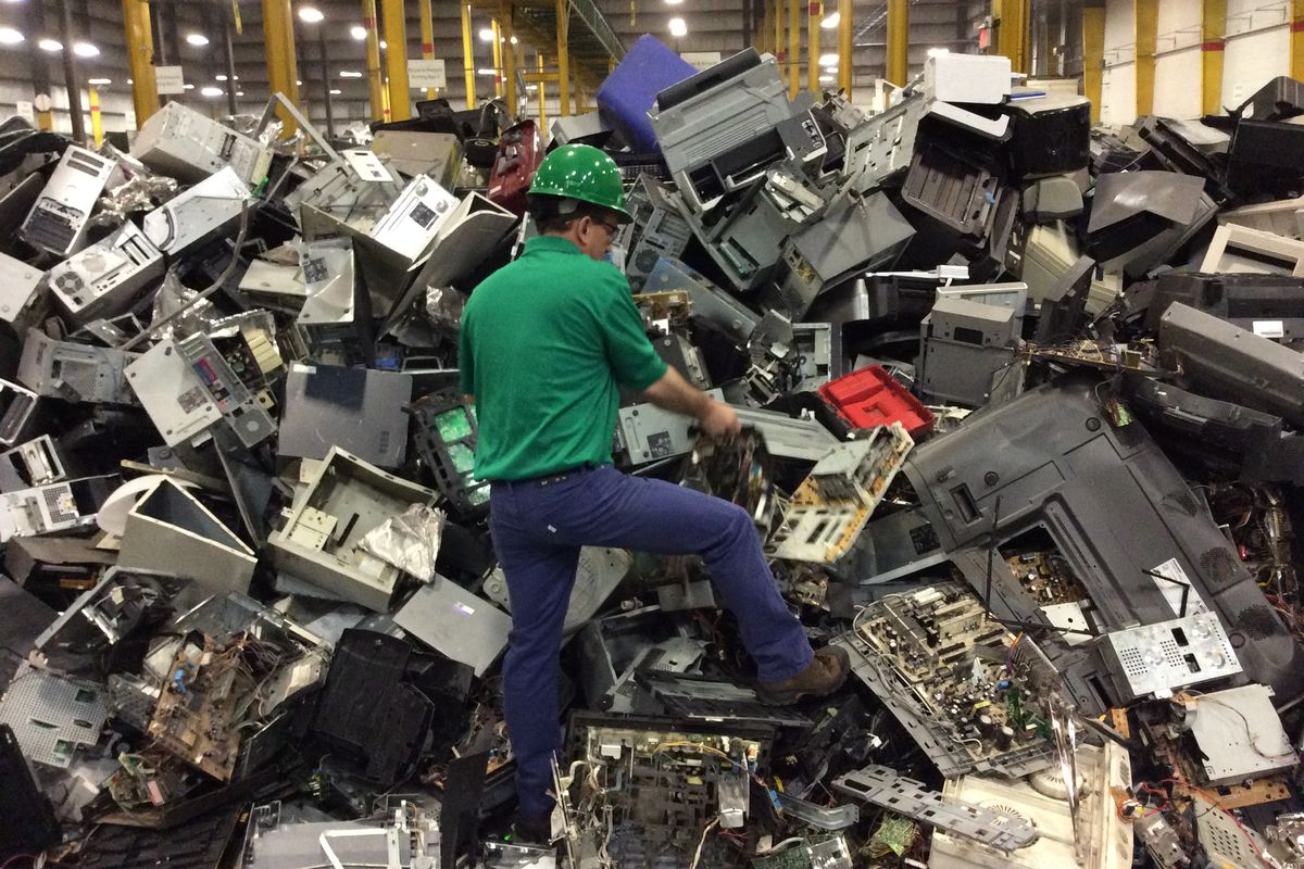 The Toxics In Our Electronics Are A Huge Problem But There May Be Recycling Machinery Circuit Board Scrap Computer An Employee Walks Through Electronic Waste Awaiting To Dismantled As Recyclable At Recyclers International Plant