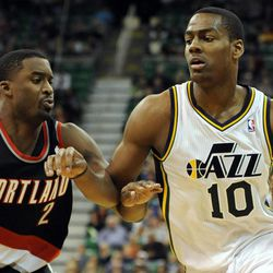 Utah Jazz point guard Alec Burks (10) drives around the defense of Portland Trail Blazers shooting guard Wesley Matthews (2) in the second half of a game at the Energy Solutions Arena on Wednesday, October 16, 2013.