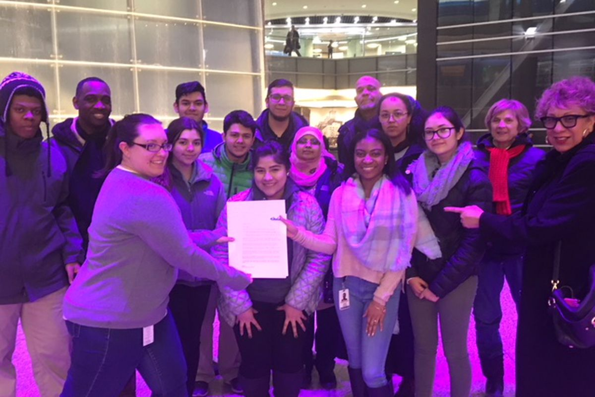 Members of the Detroit Education Justice Coalition bring a letter they wrote to businessman Dan Gilbert to a downtown office that houses some of Gilbert's businesses. The letter asks Gilbert to join a campaign that seeks more funding for public schools.