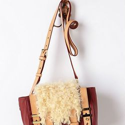 """Like something brought back from a far-flung vacation. Beracamy Helambu <a href=""""http://www.anthropologie.com/anthro/product/accessories-bags/28618478.jsp"""">cross-body bag</a>, $308."""