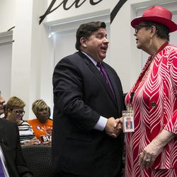 While Ald. Ameya Pawar (47th) looks on, Illinois gubernatorial candidate J.B. Pritzker shakes hands with Chicago Teachers Union President Karen Lewis before the Progressive Gubernatorial Forum on Sunday, Oct. 8, 2017.
