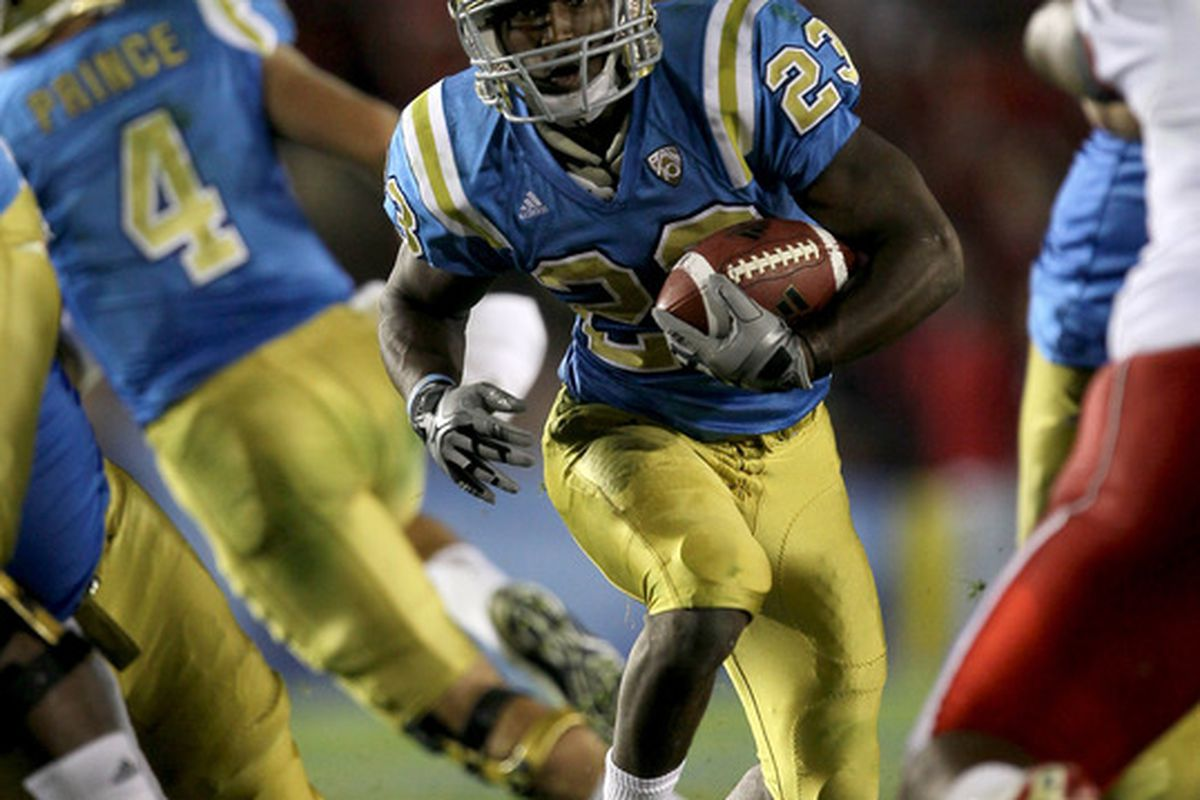 PASADENA CA - SEPTEMBER 18:  Running back Johnathan Franklin #23 of the UCLA Bruins carries the ball against the Houston Cougars in the second quarter at the Rose Bowl on September 18 2010 in Pasadena California.  (Photo by Stephen Dunn/Getty Images)