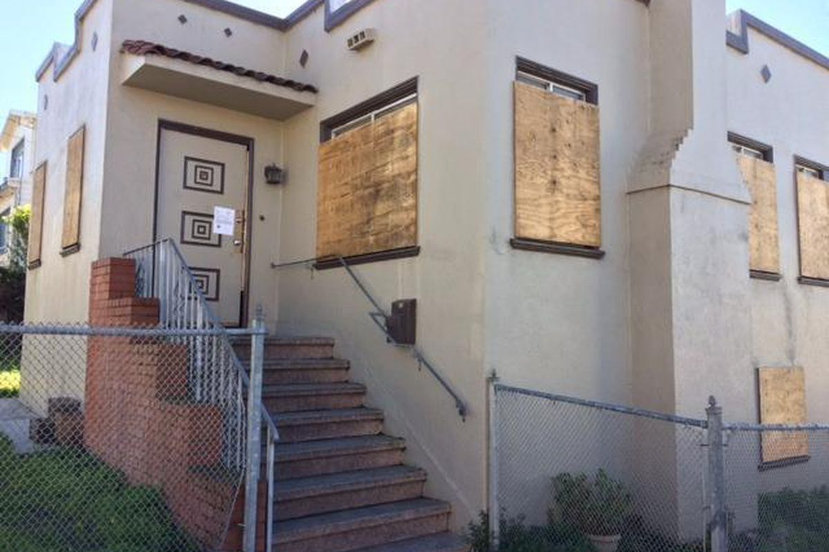 Crocker-Amazon home with no electricity and boarded windows sells ...