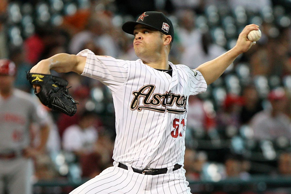July 23, 2012; Houston, TX, USA; Houston Astros starting pitcher Wandy Rodriguez (51) pitches in the first inning against the Cincinnati Reds at Minute Maid Park. Mandatory Credit: Troy Taormina-US PRESSWIRE