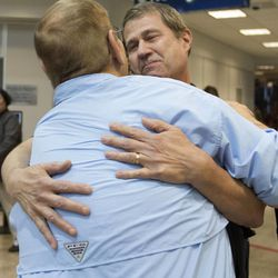 Michael Reed meets his father, Dennis Fay, for the first time at the Salt Lake City International Airport on Friday, May 15, 2015. Reed, who was placed for adoption after his birth, just found information on his birth father five months ago and flew to Salt Lake City from Chicago to meet him.