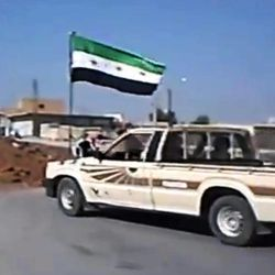 In this image taken from video obtained Wednesday, Sept. 19, 2012 from the Ugarit News, which has been authenticated based on its contents and other AP reporting, Free Syrian Army soldiers seize Ain al-Arous town in Raqqa, Syria, on Tuesday, Sept. 18, 2012.