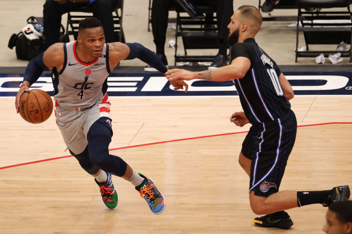 Washington Wizards guard Russell Westbrook dribbles the ball as Orlando Magic guard Evan Fournier defends in the second quarter at Capital One Arena.