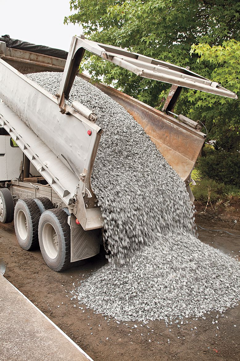 Crushed Stone Poured Onto Driveway For Permeable Layer