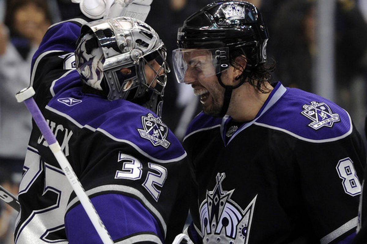 LOS ANGELES CA - NOVEMBER 04:  Drew Doughty #8 and Jonathan Quick #32 of the Los Angeles Kings react to a 1-0 win over the Tampa Bay Lightning at Staples Center on November 4 2010 in Los Angeles California.  (Photo by Harry How/Getty Images)