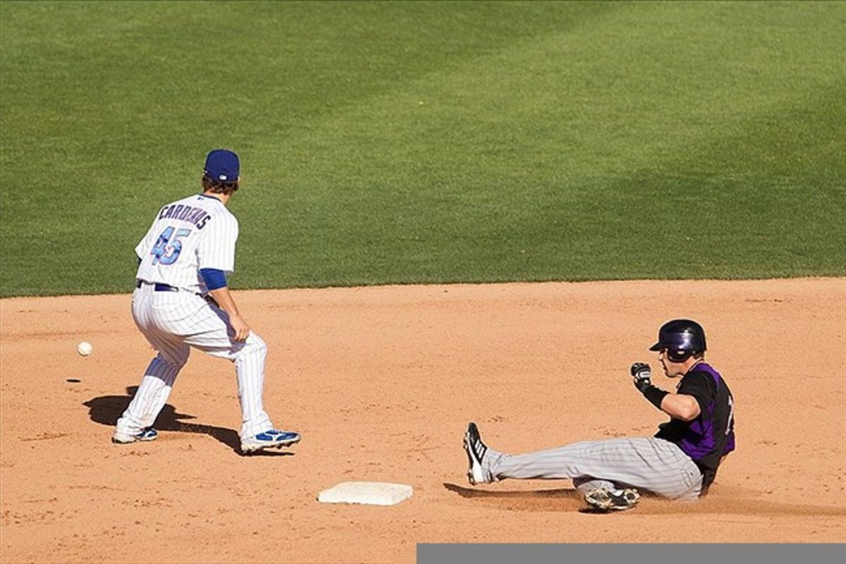 Colorado Rockies infielder Brendan Harris slides into second after a double in the seventh inning against the Chicago Cubs at HoHoKam Park. Mandatory Credit: Allan Henry-US PRESSWIRE