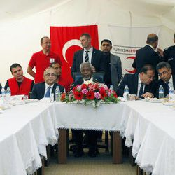 U.N.-Arab League envoy Kofi Annan, sitting at centre, is seen during a meeting with various representatives of Syrian refugees and Turkish officials at Yayladagi refugee camp in Hatay province, Turkey,  April 10, 2012.  International envoy Kofi Annan said that the bloodshed in Syria must end without any preconditions, on Tuesday, the day that marks a deadline for Syrian troops to begin withdrawing from Syrian cities, but activists say there is no sign of that happening.