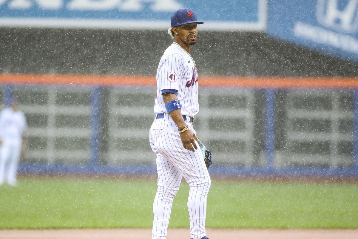 New York Mets shortstop Francisco Lindor (12) takes the field in the top of the first inning against the Miami Marlins prior to a rain delay at Citi Field.