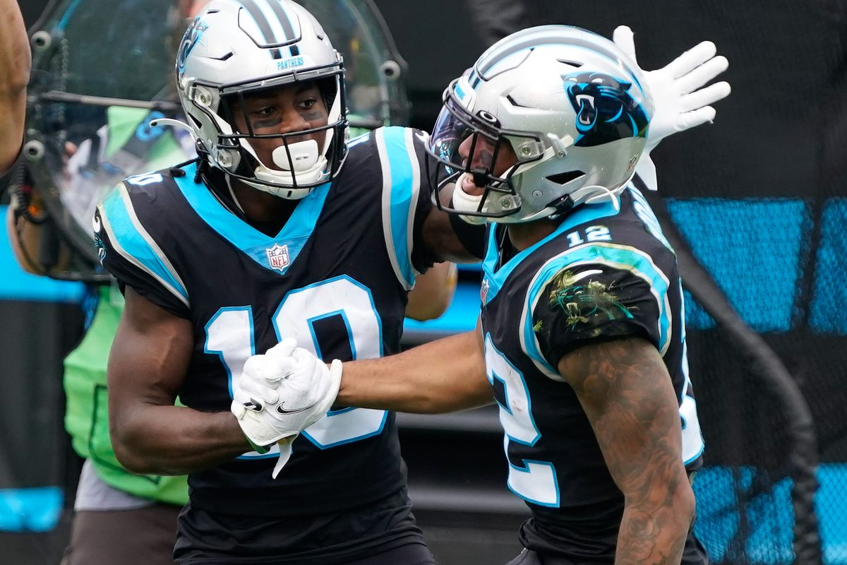 Carolina Panthers wide receiver Curtis Samuel (10) congratulates Carolina Panthers wide receiver D.J. Moore (12) during the first quarter against the Detroit Lions at Bank of America Stadium.
