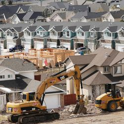 Construction work is done in Lehi on Wednesday, March 23, 2016. Salt Lake County's population of 1.1 million is almost double that of Utah County, the state's next most populous county. But Utah County could soon be gaining a larger number of people each year than its neighbor to the north thanks to a thriving tech industry and overall economic opportunity that bring in a steady stream of new residents.