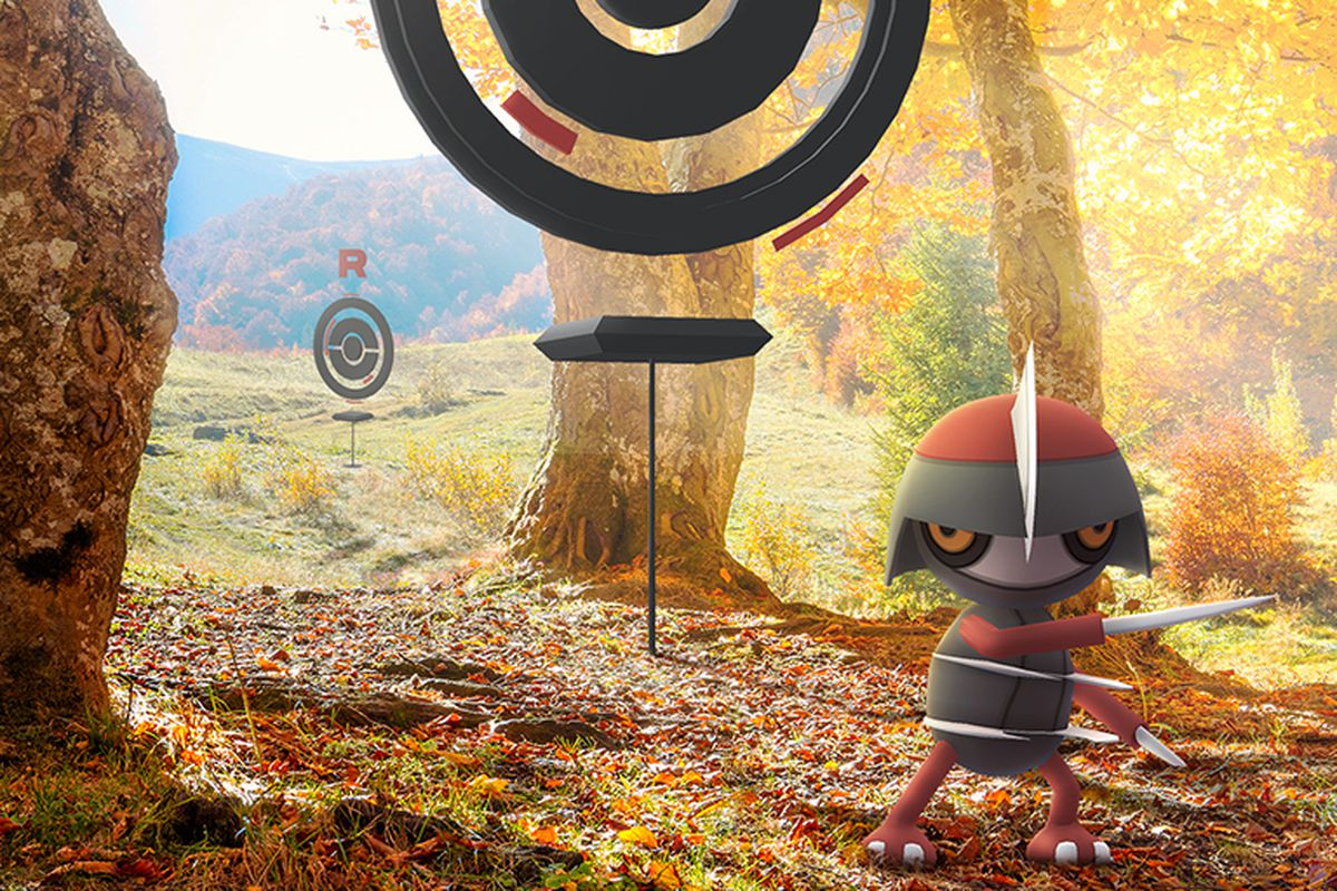 A Pawniard stands in a fall forest near some Team Go Rocket Poké Stops