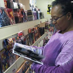 Barbara Edgerton of Kansas City, Kan., shops for comics. Experts say religious comics help people transcend past the pages and delve deeper into their own faith, as well as religions they dont understand completely.