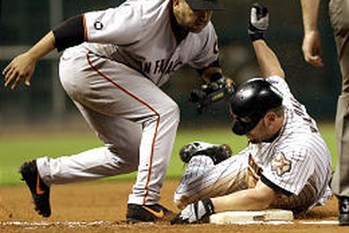 Houston pitcher Ron Villone, right, is tagged out by San Francisco third baseman Edgardo Alfonzo.