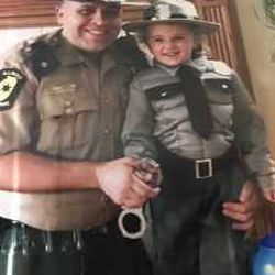 Jerry Ellis poses with one of his daughters in State Trooper uniforms. | Provided