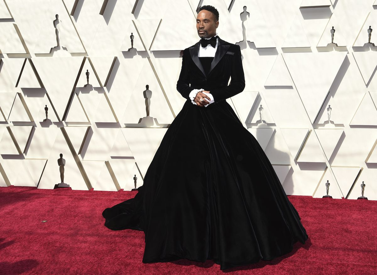 Billy Porter arrives wearing a Christian Siriano tuxedo gown at the Oscars on Sunday, Feb. 24, 2019, at the Dolby Theatre in Los Angeles. | Richard Shotwell/Invision/AP