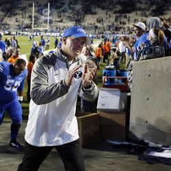 Head Coach Bronco Mendenhall of the Brigham Young University Cougars walks off the field after BYU lost to USU in NCAA football in Provo, Friday, Oct. 3, 2014.