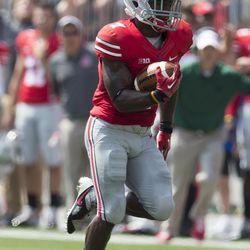 Ohio State Buckeyes running back Jordan Hall (7) runs for a touchdown against the Buffalo Bulls at Ohio Stadium.