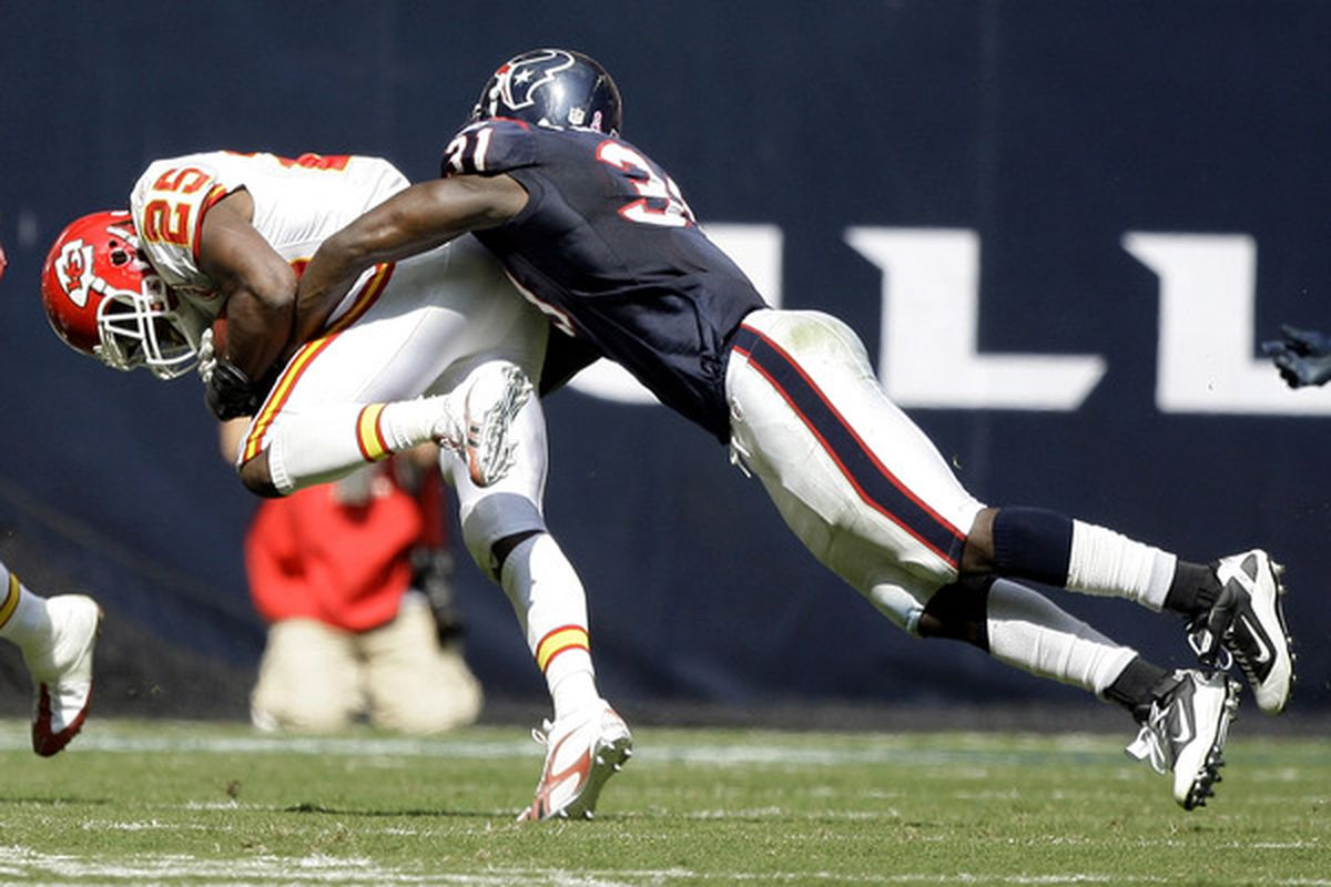HOUSTON - OCTOBER 17:  Jamaal Charles #25 of the Kansas City Chiefs is brought down by strong safety Bernard Pollard #31 of the Houston Texans at Reliant Stadium on October 17 2010 in Houston Texas.  (Photo by Bob Levey/Getty Images)