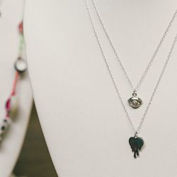 'Third Eye' necklace, $150; 'Acid Heart' necklace, $150