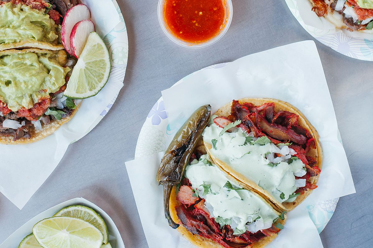 An array of tacos and drinks at Tacos El Gordo