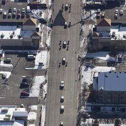 The funeral procession for Unified police officer Doug Barney travels through Holladay, where Barney served, before making its way to the Orem City Cemetery, where he will be laid to rest on Monday, Jan. 25, 2016. Barney was shot and killed in the line of duty by a man who seemingly had done nothing more than leave the scene of a traffic accident on Sunday, Jan. 17, 2016.