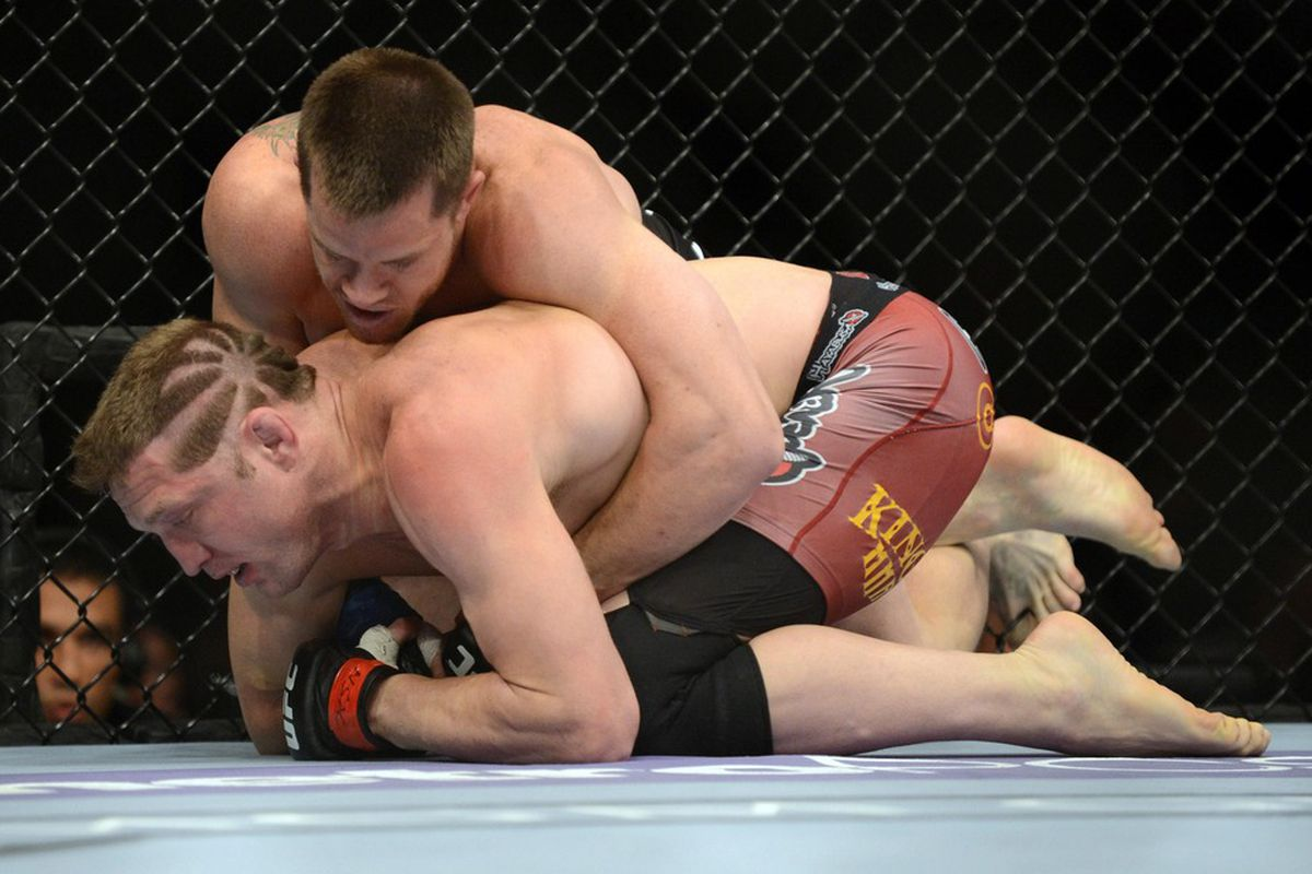 May 26, 2012; Las Vegas, NV, USA;  Jason Miller (bottom) and C.B. Dollaway (top) fight during UFC 146 at the MGM Grand Garden event center. Mandatory Credit: Ron Chenoy-US PRESSWIRE