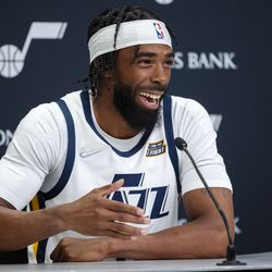Utah Jazz guard Mike Conley (11) talks during the Utah Jazz media media day at Vivint Arena in Salt Lake City on Monday, Sept. 27, 2021.