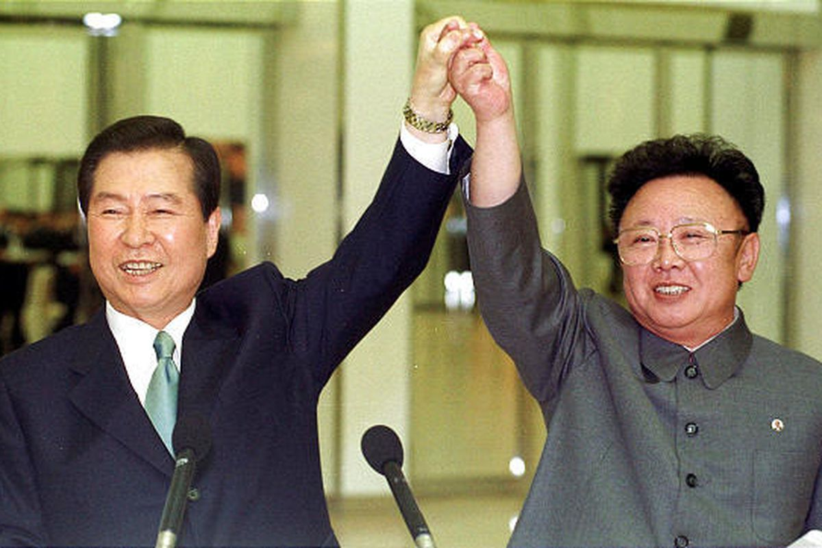 In this June 14, 2000 file photo, South Korean President Kim Dae-jung, eft, and North Korean leader Kim Jong Il raise their arms together before signing a joint declaration at the end of the second day of a three-day summit in Pyongyang, North Korea.