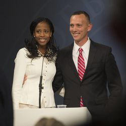 Mia Love stands with her husband, Jason Love, after debating Doug Owens at the Dolores Doré Eccles Broadcast Center on the University of Utah campus in Salt Lake City on Tuesday, Oct. 14, 2014.