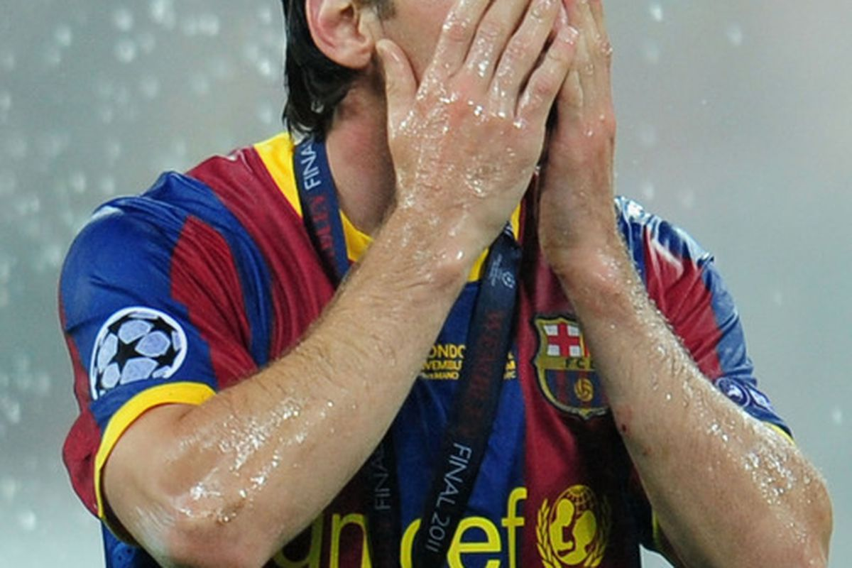 LONDON, ENGLAND - MAY 28:  Lionel Messi of FC Barcelona celebrates after the UEFA Champions League final between FC Barcelona and Manchester United FC at Wembley Stadium on May 28, 2011 in London, England.  (Photo by Shaun Botterill/Getty Images)