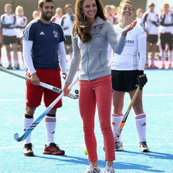 Kate wears Zara jeans and sneakers to play hockey with Great Britain's Olympic team on March 15th, 2012.